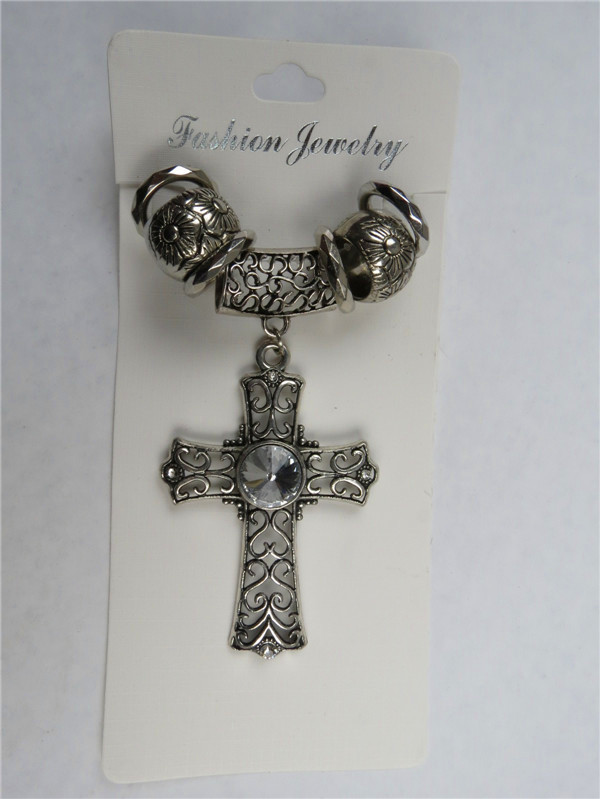 Hollow out cross style pendant with a big resin stone